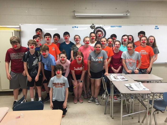 Students wear red noses to celebrate Red Nose Day.